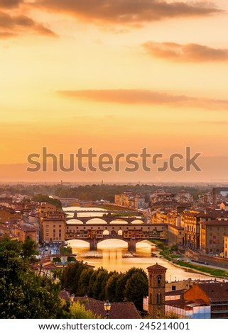 Golden sunset over the river Arno and Ponte Vecchio, Florence, Italy - stock photo
