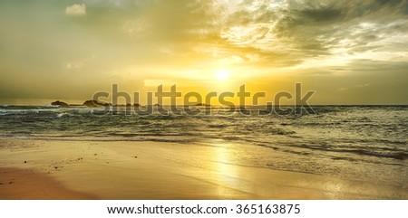Golden sunset over the sea. Sri Lanka. Panorama - stock photo