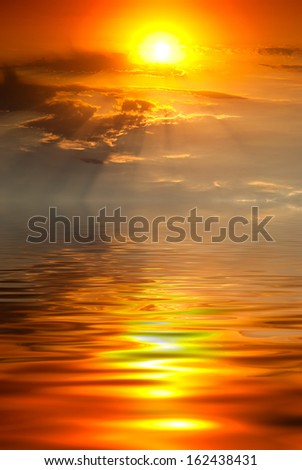 golden sunset with rays of sun on the sea - stock photo