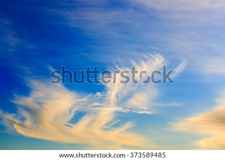 Golden sunsets clouds in blue sky - stock photo