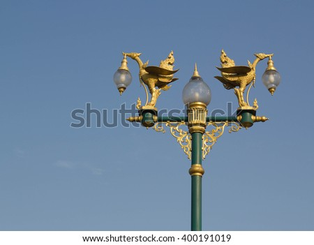 Golden supannahong Street lights (Lamp) on the road in thailand - stock photo