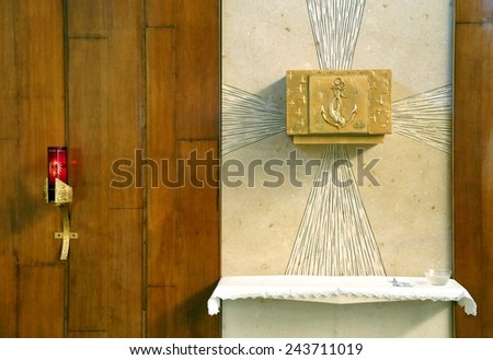 Golden Tabernacle with consecrated hosts in the Christian Church - stock photo