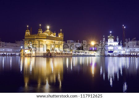 Golden Temple at night in Amritsar, Punjab, India. The most prominent Sikh Gurdwara in the world - stock photo