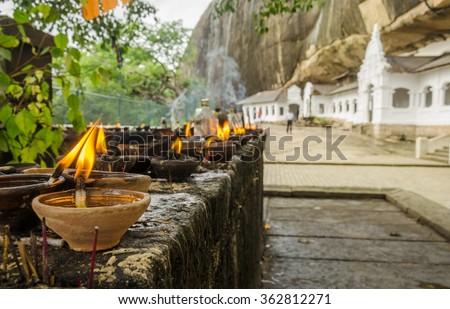 Golden Temple buddhist caves, signs of worship - Dambulla, Sri Lanka - stock photo
