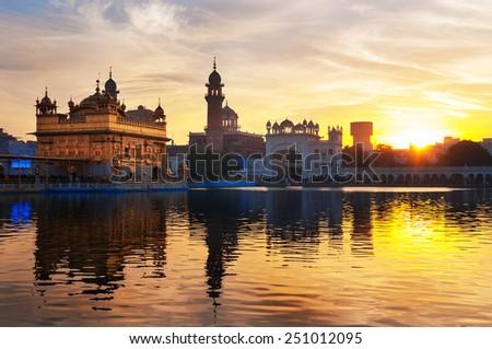 Golden Temple (Harmandir Sahib also Darbar Sahib) in the early morning at sunrise. Amritsar. Punjab. India - stock photo