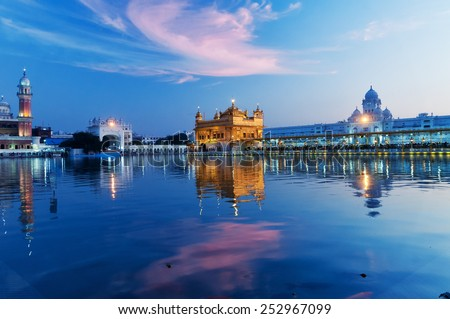 Golden Temple (Harmandir Sahib also Darbar Sahib) in the evening at sunset. Amritsar. Punjab. India - stock photo