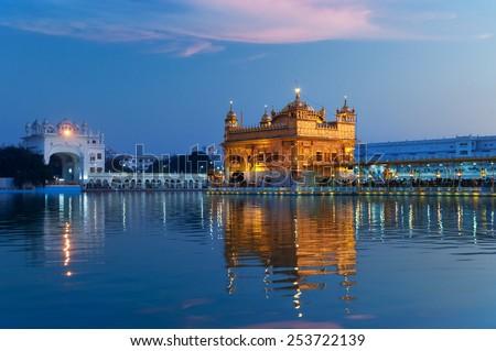 Golden Temple (Harmandir Sahib also Darbar Sahib) in the evening at sunset. Amritsar. Punjab. India - stock photo