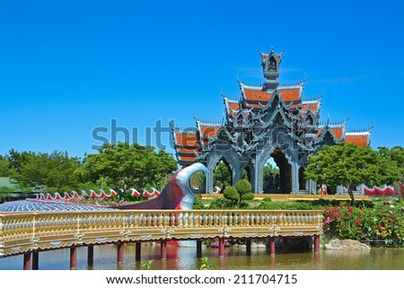 golden temple pavilion and bridge  thai art on the water at ancient siam - stock photo