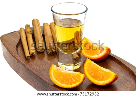 Golden tequila shot with orange and cinnamon - stock photo