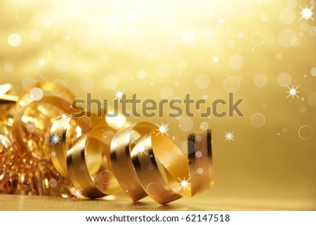 Golden theme with christmas ribbon - stock photo