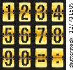 golden timetable numbers on black - stock photo
