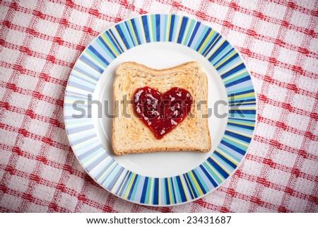 golden toast with raspberry jam - stock photo