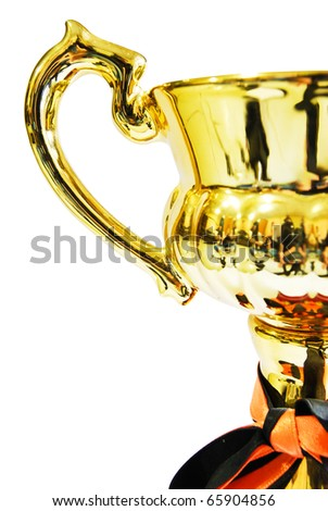 Golden trophy closeup isolated on white background - stock photo