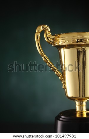 golden trophy on the green background