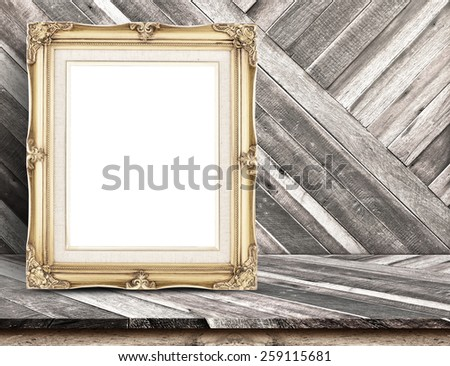 Golden Vintage frame at Diagonal tropical Wood Table top at Wooden wall,Template mock up for Business presentation background. - stock photo
