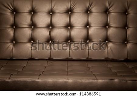 Golden Vintage leather close-up Sofa background - stock photo
