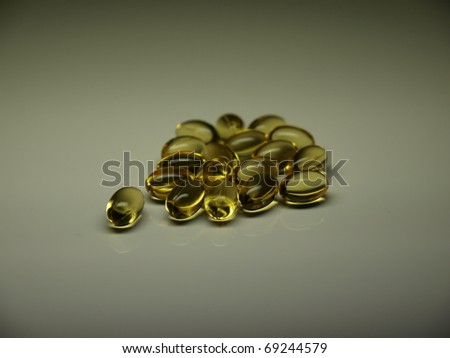 Golden vitamin pills