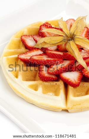 Golden waffle topped with beautiful fresh strawberries