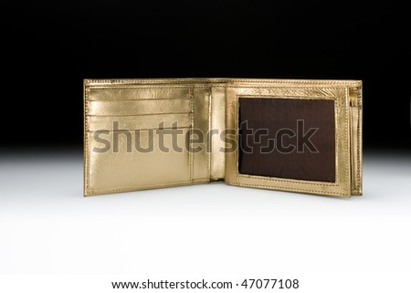 Golden wallet open - stock photo