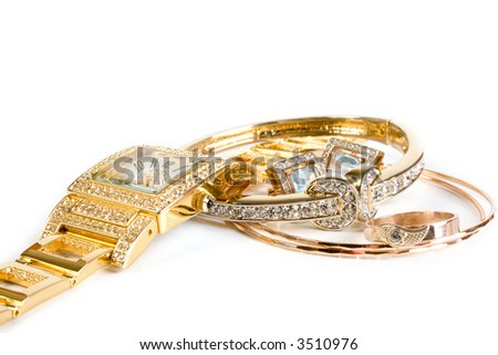 Golden watch and jewelery. Isolated on white. - stock photo