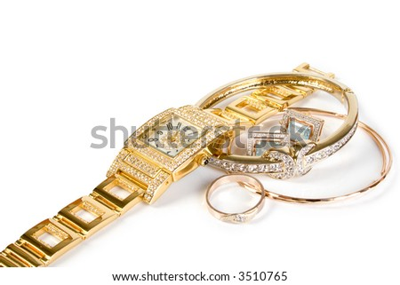 Golden watch and jewelery. Isolated on white background. - stock photo