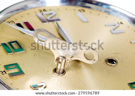 Golden watch is showing almost 12, isolated - stock photo