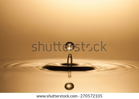 Golden Waterdrop - stock photo