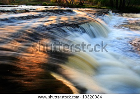Golden waterfall - stock photo