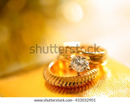 Golden Wedding Ring with Diamond on white background in vivid color filter - stock photo