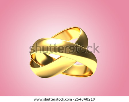 Golden wedding rings on pink background
