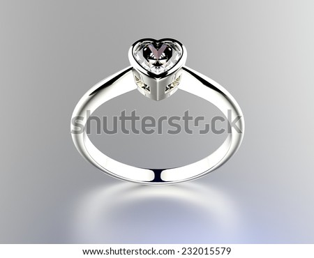Golden wedding Rings with Diamond heart shape. Jewelry background - stock photo