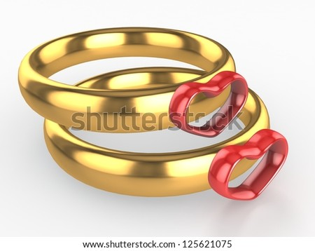 Golden wedding rings with red heart. Love concept - stock photo