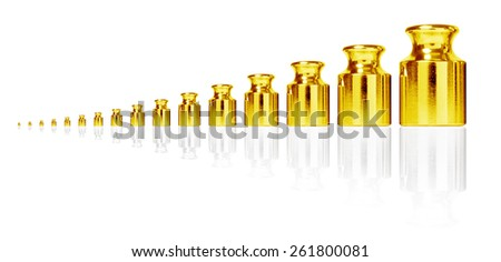 Golden weight set isolated on white. - stock photo