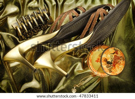 golden womans shoes ,hairgrip and box for jewellery  in greek style on golden fabric - stock photo