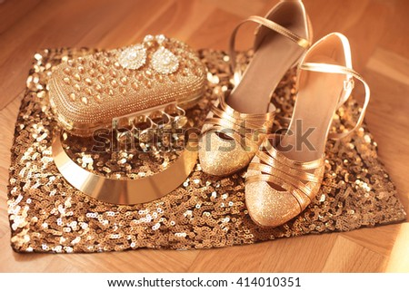 Golden. Women clothes and accessories.  Shoes. Luxury fashion  jewelry. Expensive pendant close-up background. Shiny Crystal Precious Gem Jewels - stock photo