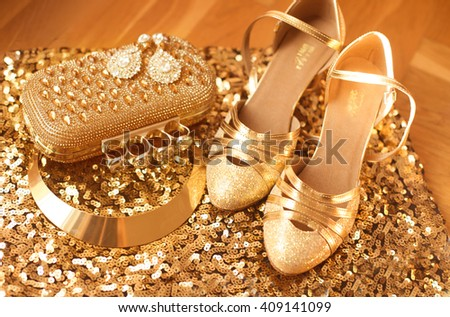 Golden. Women's clothes and accessories. Fashion Shoes. Luxury jewelry. Expensive pendant close-up background. Shiny Crystal Precious Gem Jewels - stock photo