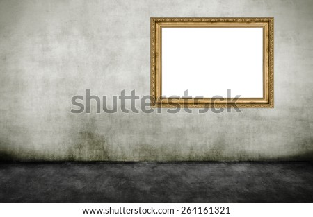 Golden wooden empty frame on dirty wall  - stock photo