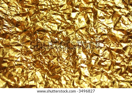 golden wrinkled Aluminum - stock photo