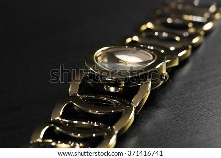 Golden wristwatch with bracelet - stock photo