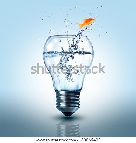 goldfish jumping out  electric bulb - stock photo