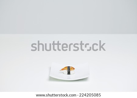 Goldfish prepared as nigiri sushi placed alone on sushi plate - stock photo