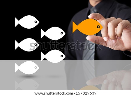 Goldfish showing leader individuality success concept - stock photo