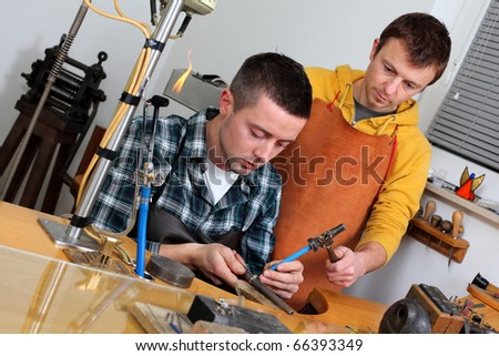 Goldsmith in workshop. Making of jewelery. Handmade. - stock photo