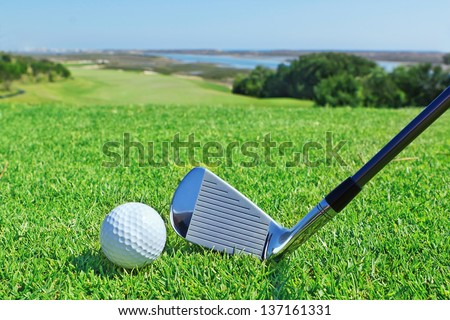 Golf accessories on a background of a green golf course. - stock photo