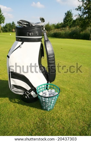 golf bag on green field - stock photo