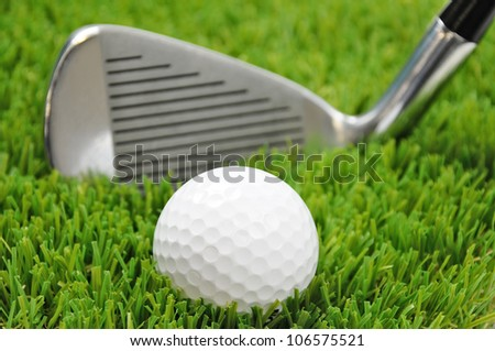 golf ball and club head with focus on the ball - stock photo