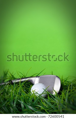 Golf ball and club in the grass on green background with copy space - stock photo