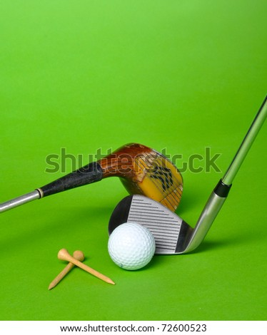 Golf ball and club isolated on green background with copy space - stock photo