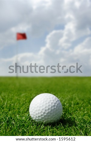 golf ball and flag -- short putt. Focus on ball - stock photo