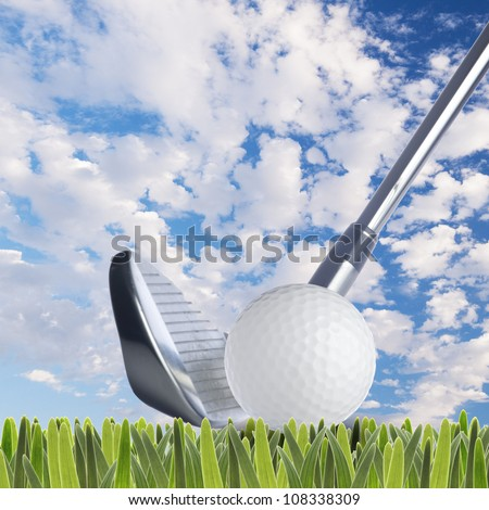 Golf ball and golf club on fresh green grass - stock photo
